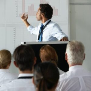 young-businessman-delivering-presentation-at-PF276WZ@2x.jpg